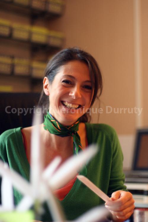 Daphne Bugey, perfumer,  smelling perfumes trials in her office. // Daphne Bugey, parfumeur, en train de sentir des essais de parfums dans son bureau.