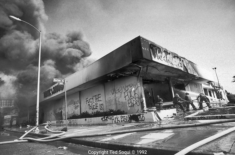 A Trak Auto store is looted and burned on Washington Blvd. near Norton.<br /> <br /> Los Angeles has undergone several days of rioting due to the acquittal of the LAPD officers who beat Rodney King.<br /> Hundreds of businesses were burned to the ground and over 55 people have been killed.