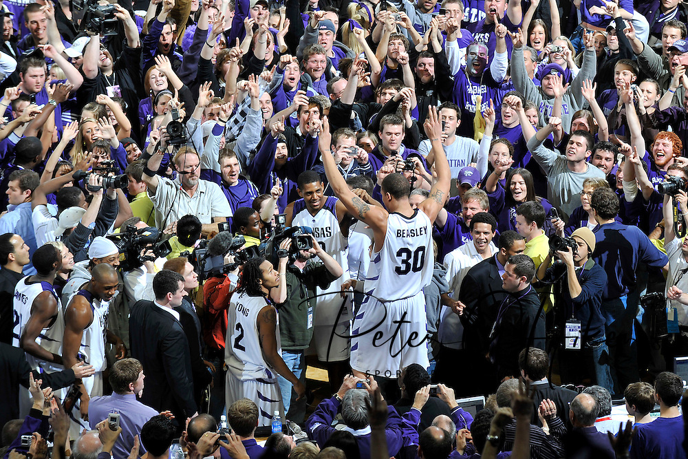 ESPN -- Kansas State Wildcats forward Michael Beasley (30) celebrates with Wildcat fans after upsetting the Kansas Jayhawks 84-75, ending a 24 year home game losing streak to the Jayhawks at Bramlage Coliseum in Manhattan, Kansas.