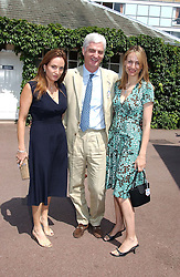 Left to right, MRS WILLIAM TURNER and MR & MRS STEVEN LUSSIER, the women are the daughters of Anthony Oppenheimer at the King George VI and The Queen Elizabeth Diamond Stakes sponsored by De Beers for the 33rd year held at Ascot Racecourse, Berkshire on July 24th 2004.