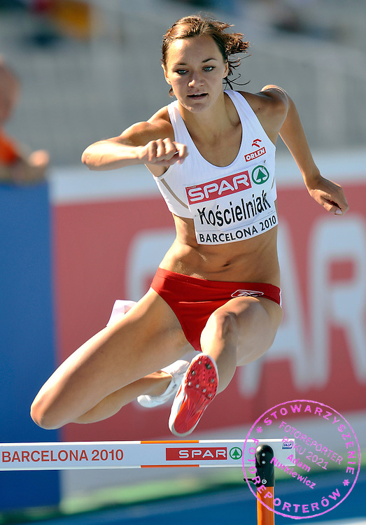 MARZENA KOSCIELNIAK (POLAND) COMPETES IN WOMEN'S 400 METERS HURDLES QUALIFICATION DURING THE 2010 EUROPEAN ATHLETICS CHAMPIONSHIPS AT OLYMPIC STADIUM IN BARCELONA, SPAIN...SPAIN , BARCELONA , JULY 27, 2010..( PHOTO BY ADAM NURKIEWICZ / MEDIASPORT )..PICTURE ALSO AVAIBLE IN RAW OR TIFF FORMAT ON SPECIAL REQUEST.