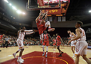 Western Kentucky Hilltoppers forward Justin Johnson (23) dunks the ball against the Southern California Trojans during an NCAA college basketball game in the second round of the NIT tournament in Los Angeles, Monday, Mar 19, 2018. WKU defeated USC 79-75.