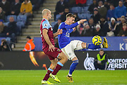 Leicester City midfielder James Maddison (10) crosses under pressure from West Ham United defender Pablo Zabaleta (5) during the Premier League match between Leicester City and West Ham United at the King Power Stadium, Leicester, England on 22 January 2020.