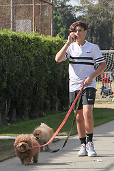 EXCLUSIVE: Gavin Rossdale and his son Kingston took tennis lessons together in Los Angeles, CA. Kingston walked his dogs while on a phone call after his lesson while Gavin practiced his game. **SPECIAL INSTRUCTIONS*** Please pixelate children's faces before publication.**. 17 Nov 2018 Pictured: Gavin Rossdale, Kingston Rossdale. Photo credit: MEGA TheMegaAgency.com +1 888 505 6342