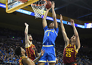 Feb 28, 2019; Los Angeles, CA, USA; UCLA Bruins center Moses Brown (1)is defended by Southern California Trojans forward Bennie Boatwright (25), guard Elijah Weaver (3) and forward Nick Rakocevic (31) in the second half at Pauley Pavilion. UCLA defeated USC 93-88 in overtime.