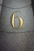 The number six in gold colour, in a doorway of offices in the City of London.