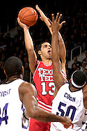 Texas Tech forward Decensae White (13) scores over Kansas State's Luis Colon (50) and Akeem Wright (34) in the first half at Bramlage Coliseum in Manhattan, Kansas, January 8, 2007.  Texas Tech defeated K-State 62-52.