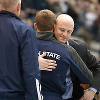 February 23, 2014; State College, PA, USA; Penn State head coach Cael Sanderson hugs David Taylor after he was introduced to a sell-out crowd at Rec Hall during senior recognition before the Nittany Lions match against the Clarion Eagles. Penn State defeated Clarion 43-3.