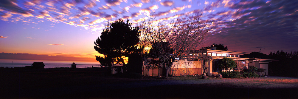 Panoramic photograph of a Mid-century Modern house at sunset on Orcas Island along Puget Sound in Washington USA.©Rich Frishman.