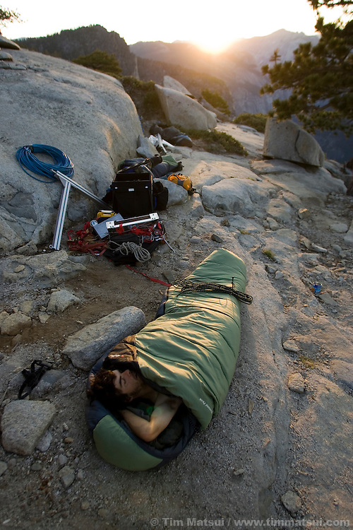 Climber Nicola Martinez still asleep at dawn on top of El Capitan for the filming of Am Limit, a Lotus Film production, about the climbing brothers Alexander and Thomas Huber and their attempt to break the speed climbing record on the Nose of El Capitan in Yosemite National Park, California, USA.