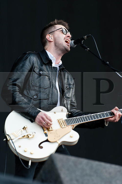 """© Licensed to London News Pictures. 07/06/2013. London, UK.   James Fray of The Courteeners performing live at Finsbury Park, supporting headliner The Stone Roses.   The Courteeners are an English indie rock band formed in Middleton, Greater Manchester in 2006 by Liam James Fray (guitar/vocals), Michael Campbell (drums/backing vocals), Daniel """"Conan"""" Moores (guitar), and Mark Joseph Cuppello (bass).  Photo credit : Richard Isaac/LNP"""