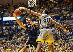 Dec 5, 2017; Morgantown, WV, USA; Virginia Cavaliers forward Isaiah Wilkins (21) drives down the lane and is guarded by West Virginia Mountaineers forward Sagaba Konate (50) during the first half at WVU Coliseum. Mandatory Credit: Ben Queen-USA TODAY Sports