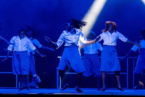 Zeta Phi Beta sorority stepping on stage for the Greek Step Show.