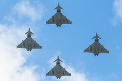 London, UK. 8 June, 2019. Four Eurofighter Typhoon swing-role combat aircraft fly over the Mall towards Buckingham Palace following the Trooping the Colour ceremony to mark the Queen's official birthday.