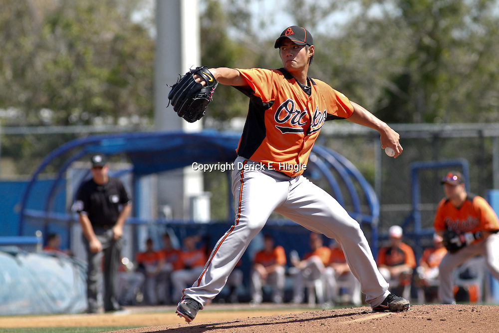 March 12, 2012; Dunedin, FL, USA; Baltimore Orioles starting pitcher Wei-Yin Chen (16) throws during the bottom of the first inning of a spring training game against the Toronto Blue Jays at Florida Auto Exchange Stadium. Mandatory Credit: Derick E. Hingle-US PRESSWIRE