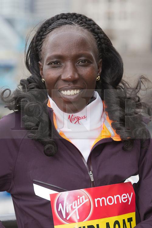 © Licensed to London News Pictures. 18/04/2013. London, England. Pictured: Kenyan Runner Edna Kiplagat. Virgin London Marathon - Photocall with International Women Runners Athletes Tiki Gelana (ETH), Edna Kiplagat (KEN), Priscah Jeptoo (KEN) and Yoko Shibui (JPN) at Tower Bridge ahead of Sunday's run, London. Photo credit: Bettina Strenske/LNP