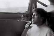 Man smoking a joint in the back of a van, UK, 1985