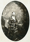 African woman with white skin due to lack of Melanin.  Her child which is on her lap has normal pigmentation. Photograph c1880.