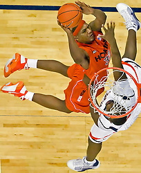 Virginia Tech forward J.T. Thompson (33) shoots over Virginia center Tunji Soroye (21).  The Virginia Cavaliers defeated the Virginia Tech Hokies 75-61 at the John Paul Jones Arena on the Grounds of the University of Virginia in Charlottesville, VA on February 18, 2009.