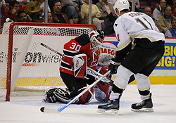 Mar 14, 2007; East Rutherford, NJ, USA;  New Jersey Devils goalie Martin Brodeur (30) makes a save on Pittsburgh Penguins center Jordan Staal (11) during the second period at Continental Airlines Arena in East Rutherford, NJ. Mandatory Credit: Ed Mulholland-US PRESSWIRE Copyright © 2007 Ed Mulholland