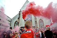 A young Liverpool fan holds up a smoke flare as Liverpool fans enjoy the atmosphere in a city square in Basel pictured ahead of the UEFA Europa League Final at St. Jakob-Park, Basel<br /> Picture by Kristian Kane/Focus Images Ltd 07814482222<br /> 18/05/2016