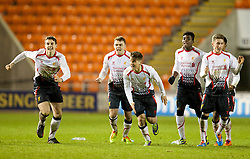 BLACKPOOL, ENGLAND - Wednesday, December 18, 2013: Liverpool players celebrate as they beat Blackpool after a penalty shoot-out (4-3) during the FA Youth Cup 3rd Round match at Bloomfield Road. L-R: Jordan Williams, captain Conor Randall, Sergi Canos, Sheyi Ojo, Jerome Sinclair, Harry Wilson. (Pic by David Rawcliffe/Propaganda)