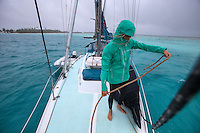 Patagonia ambassador Liz Clark resetting her anchor during some morning bad weather in French Polynesia.