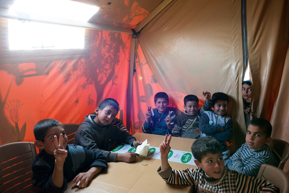 Syrian boys inside a tent serving as a school in a refugee camp in Atmeh, Syria.