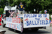 BAR HARBOR, MAINE, July 4, 2014. The Rotary Club float ends the Independence Day Parade.