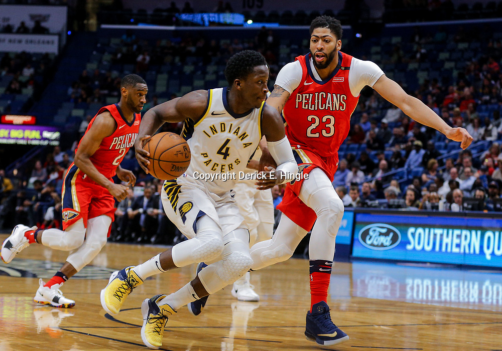 Mar 21, 2018; New Orleans, LA, USA; Indiana Pacers guard Victor Oladipo (4) drives past New Orleans Pelicans forward Anthony Davis (23) during the first quarter at the Smoothie King Center. Mandatory Credit: Derick E. Hingle-USA TODAY Sports