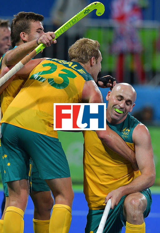 Australia's Glenn Turner and Daniel Beale celebrate a goal during the men's field hockey Britain vs Australia match of the Rio 2016 Olympics Games at the Olympic Hockey Centre in Rio de Janeiro on August, 10 2016. / AFP / Carl DE SOUZA        (Photo credit should read CARL DE SOUZA/AFP/Getty Images)