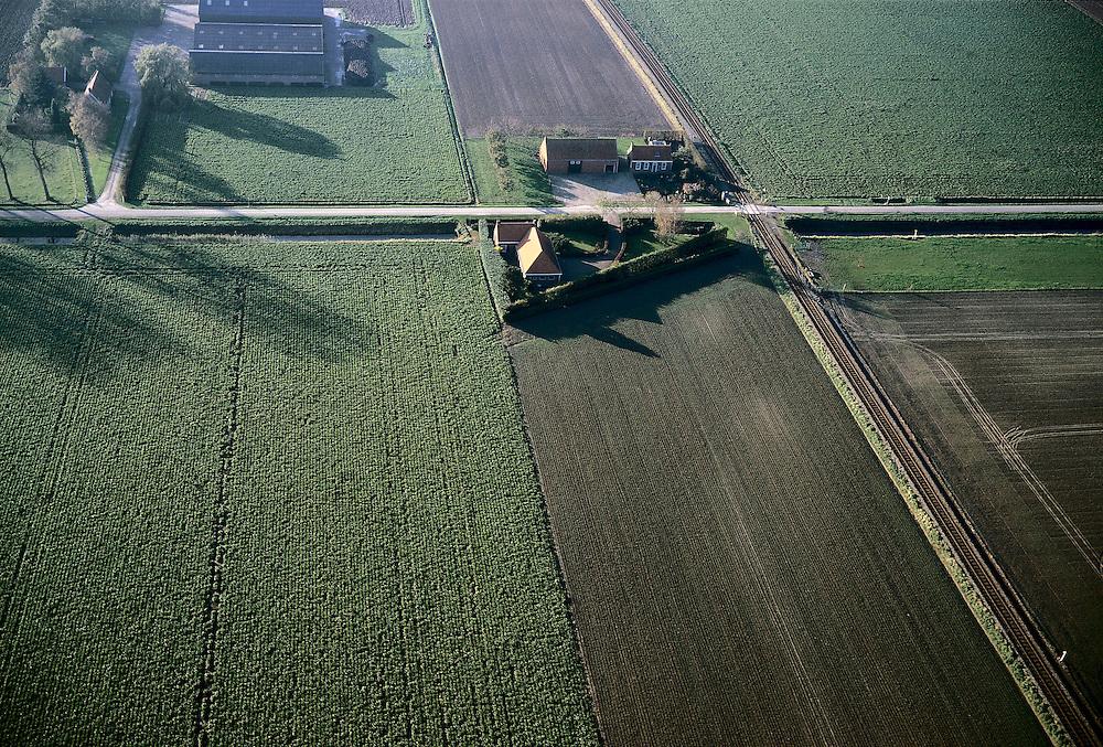 Nederland, Zeeland, Zuid-Beveland, 15/11/2001; boerderij met historische en hedendaagse stallen, kruising met enkelspoors goederenspoorlijn (naar Sloegebied);.akkers met geploegde voren, polder, platteland, landbouw, typisch Nederlands cultuurlandschap.<br /> luchtfoto (toeslag), aerial photo (additional fee)<br /> photo/foto Siebe Swart