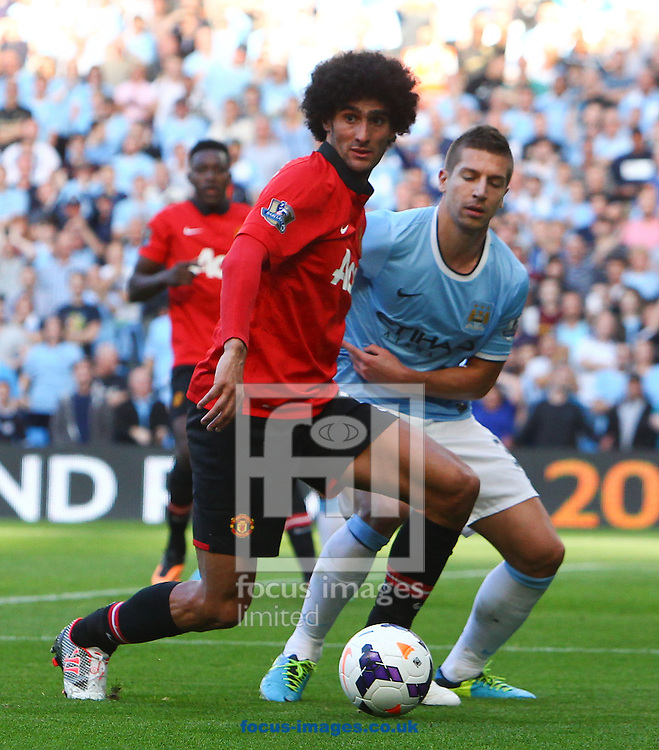 Picture by John Rainford/Focus Images Ltd +44 7506 538356<br /> 22/09/2013<br /> Matija Nastasic of Manchester City and Marouane Fellaini of Manchester United during the Barclays Premier League match at the Etihad Stadium, Manchester.