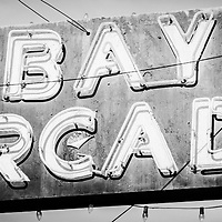 Bay Arcade sign panorama photo in Newport Beach. Panorama photo ratio is 1:3 and picture is black and white. The Bay Arcade is located in the Balboa Fun Zone in Orange County Southern California.