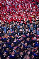 Graduates listen to the commencement speaker.