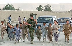 British International Security Forces patrol through a neighborhood of Kabul, Afghanistan  August 7, 2002 .    (photo by Ami Vitale)