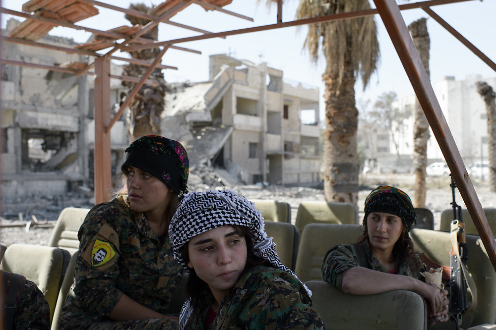 Fighters of YPJ sitting on the edge of Al-Naim Square. Raqqa, Syria, October 18, 2017