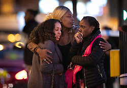 © Licensed to London News Pictures. 29/03/2019. London, UK. Three women console themselves near the Belle Vue pub next to Clapham Common tube station after a 40 year man was stabbed to death earlier this afternoon. Photo credit: Peter Macdiarmid/LNP