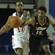 Delaware 87ers Guard Lorenzo Brown (17) and Erie BayHawks Guard Scott Suggs (15) battles of the loose ball in the second half of a NBA D-league regular season basketball game between Delaware 87ers (76ers) and the Erie BayHawks (Knicks) Friday, Jan. 3, 2014 at The Bob Carpenter Sports Convocation Center, Newark, DE