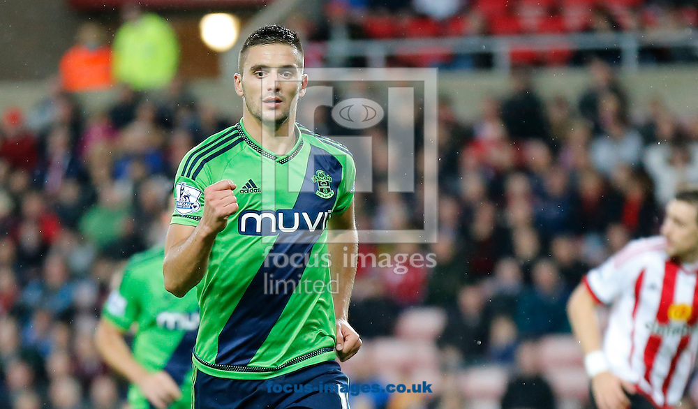 Dusan Tadic of Southampton celebrates scoring the opening goal during the Barclays Premier League match at the Stadium Of Light, Sunderland<br /> Picture by Simon Moore/Focus Images Ltd 07807 671782<br /> 07/11/2015