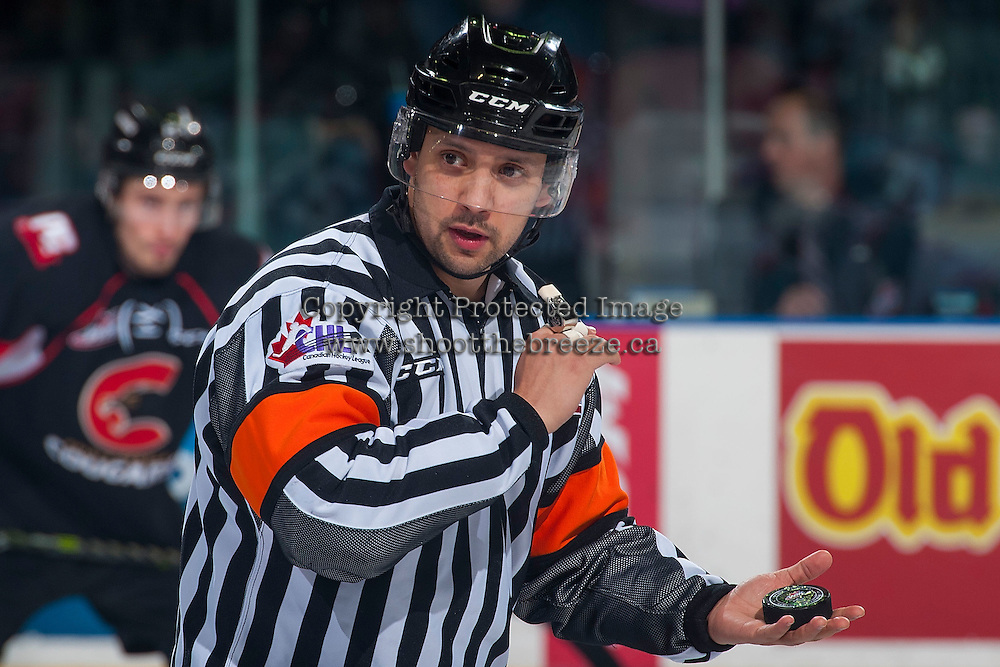 KELOWNA, CANADA - MARCH 1: Referee Sean Raphael prepares to drop the puck between Kelowna Rockets and Prince George Cougars on MARCH 1, 2017 at Prospera Place in Kelowna, British Columbia, Canada.  (Photo by Marissa Baecker/Shoot the Breeze)  *** Local Caption ***