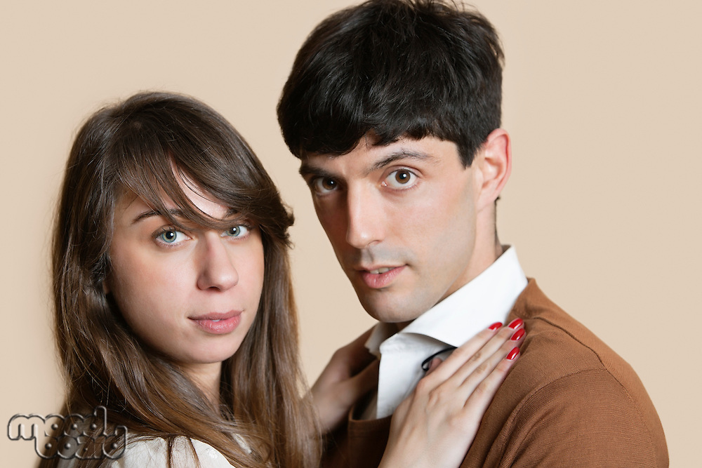 Portrait of a young Hispanic couple over colored background