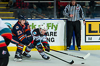 KELOWNA, BC - DECEMBER 27:  Ryley Appelt #23 of the Kamloops Blazers back checks Liam Kindree #26 of the Kelowna Rockets during first period at Prospera Place on December 27, 2019 in Kelowna, Canada. (Photo by Marissa Baecker/Shoot the Breeze)
