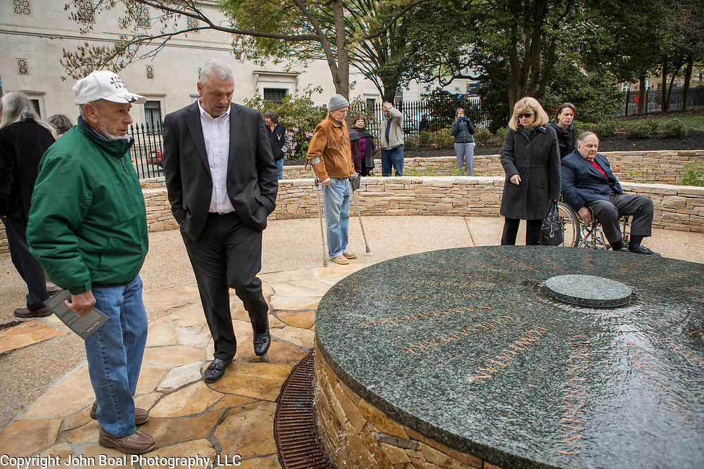Monacan Chief, Dean Branham, center and his cousin, Branch Branham, survey the new monument, Mantle: Virginia Indian Tribute, built on the Virginia State Capitol Square, in Richmond, Virginia, on Tuesday, April 17, 2018. John Boal Photography