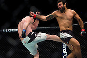 Rafael Natal connects with a spinning back fist against Tim Boetsch during UFC 205 at Madison Square Garden in New York, New York on November 12, 2016.  (Cooper Neill for The Players Tribune)