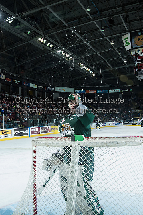 KELOWNA, CANADA - DECEMBER 30: Carter Hart #70 of Everett Silvertips ritually shoots the water in the air before taking a drink against the Kelowna Rockets on December 30, 2015 at Prospera Place in Kelowna, British Columbia, Canada.  (Photo by Marissa Baecker/Shoot the Breeze)  *** Local Caption *** Carter Hart;