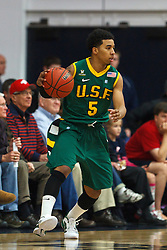 Jan 9, 2012; Moraga CA, USA;  San Francisco Dons guard Michael Williams (5) dribbles the ball against the St. Mary's Gaels during the first half at McKeon Pavilion.  St. Mary's defeated San Francisco 87-72. Mandatory Credit: Jason O. Watson-US PRESSWIRE