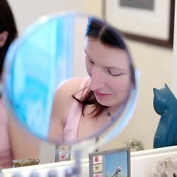 Adult lifestyle. Woman's face reflected in mirror.