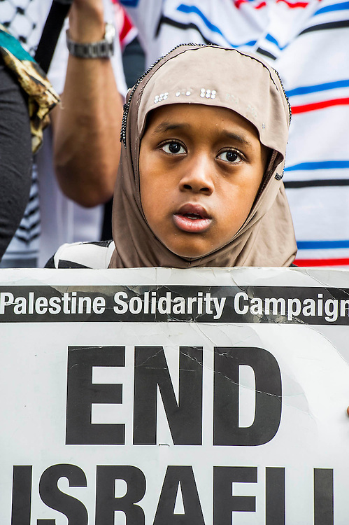 """Stop the 'massacre' in Gaza protest. They assembled at the Israeli Embassy. They called for """"Israel's bombing and killing to stop now and for David Cameron to stop supporting Israeli war crimes"""". London, 01 August 2014."""