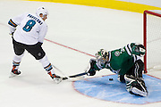DALLAS, TX - OCTOBER 17:  Dan Ellis #30 of the Dallas Stars blocks the shot of Joe Pavelski #8 of the San Jose Sharks during a shootout on October 17, 2013 at the American Airlines Center in Dallas, Texas.  (Photo by Cooper Neill/Getty Images) *** Local Caption *** Dan Ellis; Joe Pavelski